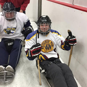playing sledgehockey